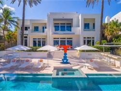Gekleurde strandhuis Tommy Hilfiger in Miami te koop voor 30 miljoen dollar